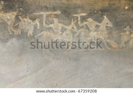 A prehistoric cave painting in Bhimbetka -India , a world heritage site which shows a war scene with warriors with their weapons on their horses. - stock photo