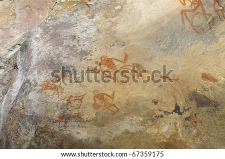 A prehistoric cave painting in Bhimbetka -India , a world heritage site which shows lifestyle of the cave men. - stock photo