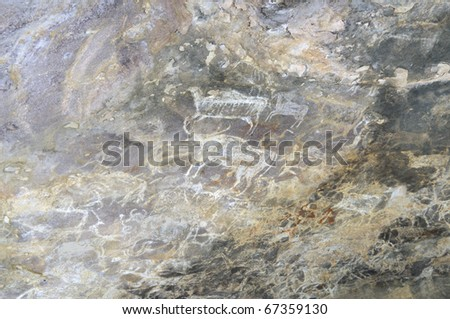 A prehistoric cave painting in Bhimbetka -India , a world heritage site which shows  wild animals. - stock photo