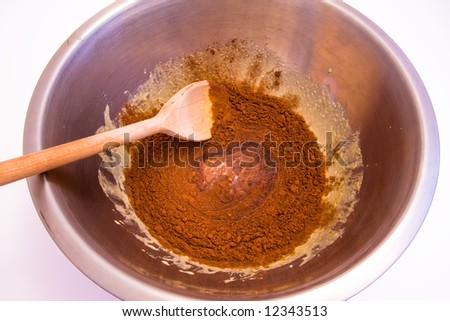 a preparation of chocolate cake in a bowl - stock photo