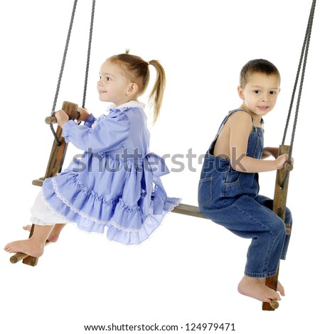 A preschool brother and sister swinging on an antique, 2-person, wooden pump-style swing.  The girl is delighted, the boy worried.  On a white background.