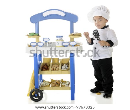 "A preschool ""chef"" becoming stupified from snitching goodies from his vendor stand.  The stand's signs left blank for your text.  On a white background. - stock photo"