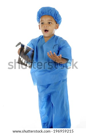 "A preschool ER ""doctor"" explaining the foot x-ray he holds in his hand.  On a white background. - stock photo"