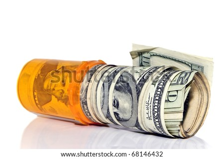 A prescription pill bottle with rolls of cash in it.  Concept or metaphor for cost of drugs. - stock photo