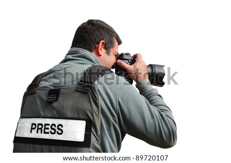 A press photographer takes photos with a professional camera - stock photo