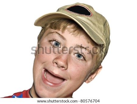 A preteen boy wearing a baseball style cap. - stock photo