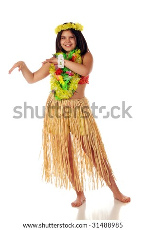 preteen girl in Hawaiian leis and a grass skirt preparing to dance ...