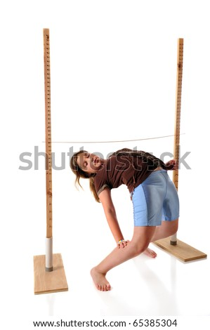 A preteen girl playing limbo.  She's bending backwards under the limbo stick.  Isolated on white. - stock photo