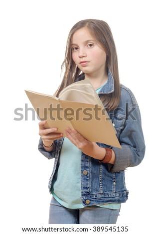 a preteen girl reads a book - stock photo