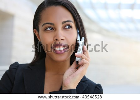 A pretty african american business woman at her office building - stock photo