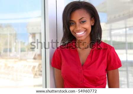 A pretty african american business woman at office - stock photo