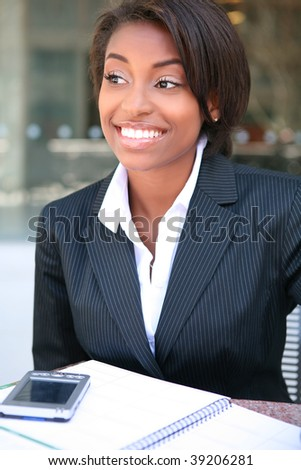 A pretty african american business woman at workplace - stock photo