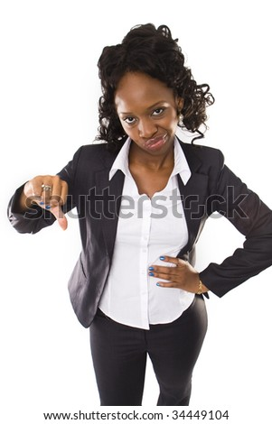 A pretty african american business woman with thumbs down - stock photo