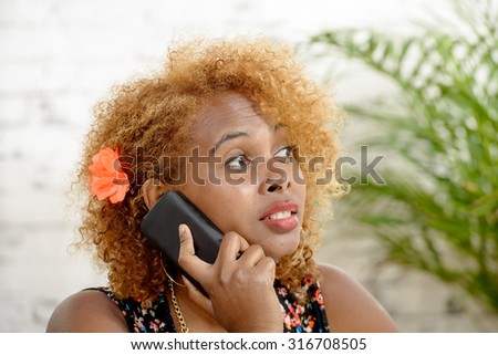 a pretty African woman with red hairs, phone