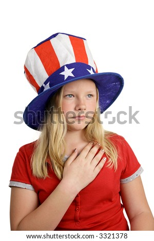 A pretty American girl in a stars and stripes hat, solemnly saying the pledge of allegiance.  Isolated on white.