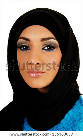 A pretty and young teen girl with a black headscarf and nice makeup looking into the camera for white background.