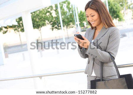 A pretty asian business woman at her office building - stock photo