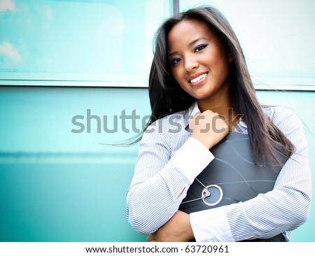 A pretty asian business woman at the office building - stock photo