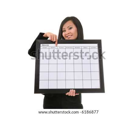 A pretty asian business woman holding a calendar