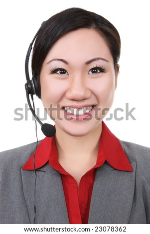 A pretty asian business woman on phone - stock photo