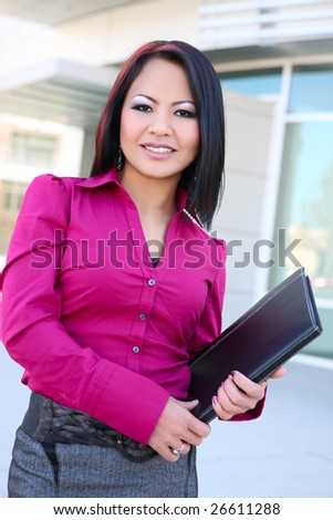 A pretty asian business woman on the cell phone