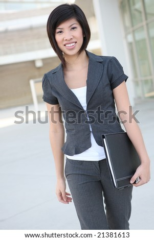 A pretty asian business woman walking to the office