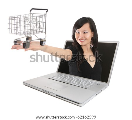 A pretty asian woman with shopping cart coming out of laptop computer (Focus on Basket)