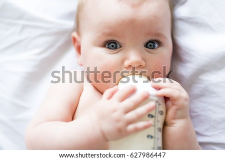 pretty baby girl drinks water bottle stock photo edit now