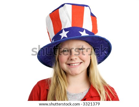 A pretty blond little girl smiling in a stars and stripes hat for Fourth of July.  Isolated on white.