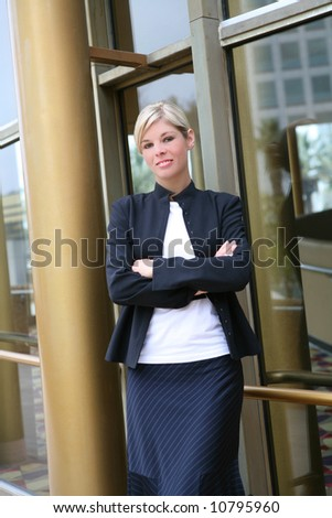 A pretty blonde business woman with arms crossed