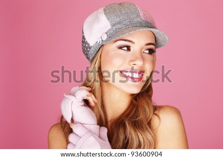 A pretty blonde woman giving a beautiful big smile wearing corduroy cap - stock photo