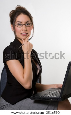 A Pretty Brunette With A Laptop Computer - stock photo