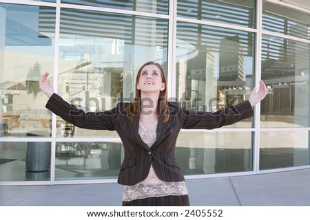 A pretty business woman celebrating success - stock photo