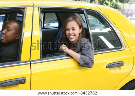 A pretty business woman getting out of a taxi cab - stock photo
