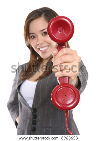 A pretty business woman holding a red phone - stock photo