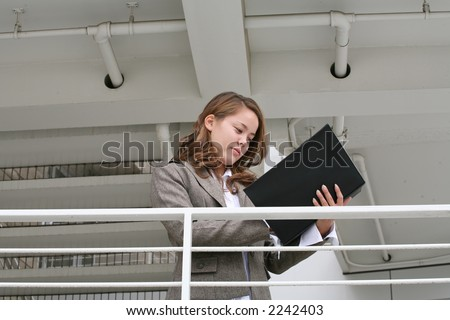A pretty business woman reviewing her notes