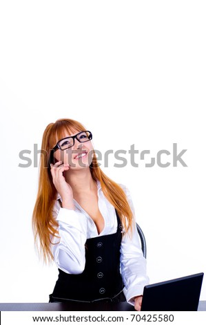 A pretty business woman sitting at table and speaking on the phone
