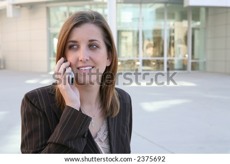 A pretty business woman taking a break and talking on the phone - stock photo
