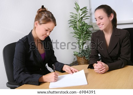 A pretty business woman team in the office - stock photo