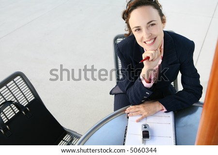 A pretty business woman working at a table - stock photo