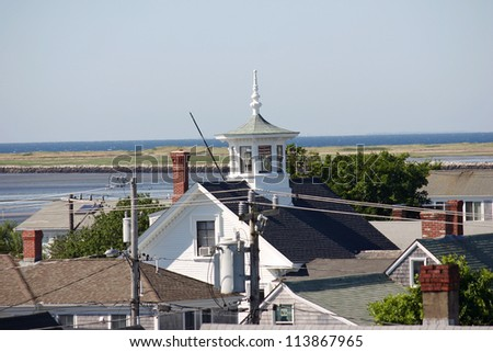 A pretty cupola with the coastline of Provincetown, Massachusetts in the background - stock photo