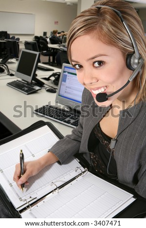 A pretty customer service woman taking notes - stock photo