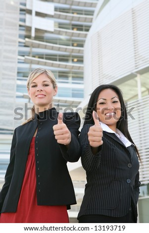 A pretty, diverse, young business team celebrating a success - stock photo