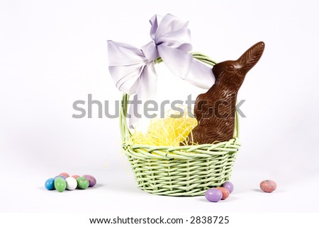 A pretty easter basket with chocolate bunny