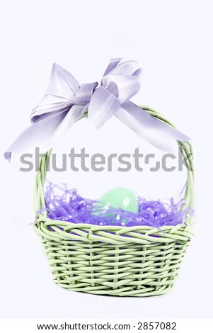 A pretty easter basket with purple easter grass