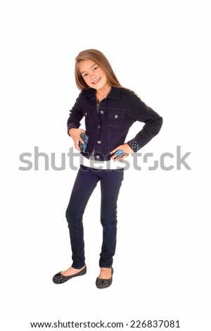 A pretty eight year old girl standing isolated for white background in jeans and a jean jacket  - stock photo