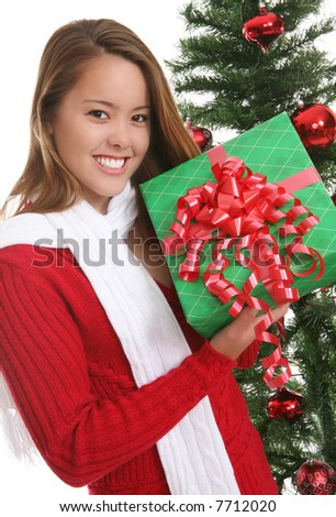A pretty girl at Christmas holding her presents