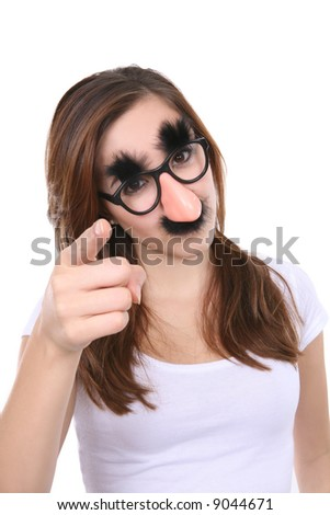 A pretty girl disguised with fake glasses, nose, and mustache - stock photo
