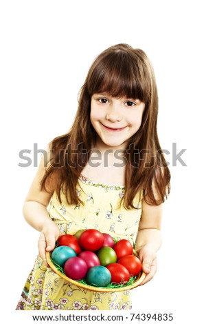 A pretty girl happy with her Easter eggs