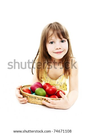 A pretty girl happy with her Easter eggs - stock photo